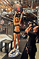 LAS VEGAS, NV - OCTOBER 24:  UFC Octagon Girl Chrissy Blair signals the start of round three between Team Edgar fighter Hector Urbina and Team Penn fighter Cathal Pendred in their preliminary fight during filming of season nineteen of The Ultimate Fighter on October 24, 2013 in Las Vegas, Nevada. (Photo by Jeff Bottari/Zuffa LLC/Zuffa LLC via Getty Images) *** Local Caption *** Chrissy Blair