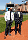 BALTIMORE, MD - APRIL 24:  (L-R) Phil Davis and Anthony Johnson pose for photos on the field at Camden Yards on April 24, 2014 in Baltimore, Maryland. (Photo by Josh Hedges/Zuffa LLC/Zuffa LLC via Getty Images)