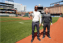 "BALTIMORE, MD - APRIL 24:  (L-R) UFC light heavyweight champion Jon ""Bones"" Jones and opponent Glover Teixeira pose for photos on the field at Camden Yards on April 24, 2014 in Baltimore, Maryland. (Photo by Josh Hedges/Zuffa LLC/Zuffa LLC via Getty Images)"