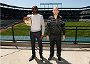 "BALTIMORE, MD - APRIL 24:  (L-R) UFC light heavyweight champion Jon ""Bones"" Jones and opponent Glover Teixeira pose for photos at Camden Yards on April 24, 2014 in Baltimore, Maryland. (Photo by Josh Hedges/Zuffa LLC/Zuffa LLC via Getty Images)"
