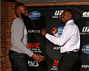 "BALTIMORE, MD - APRIL 24:  (R-L) Phil Davis jokingly attempts to face off with UFC champion Jon ""Bones"" Jones during the UFC 172 media day at Camden Yards on April 24, 2014 in Baltimore, Maryland. (Photo by Josh Hedges/Zuffa LLC/Zuffa LLC via Getty Images)"