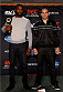 "BALTIMORE, MD - APRIL 24:  (L-R) UFC light heavyweight champion Jon ""Bones"" Jones and opponent Glover Teixeira pose for photos during the UFC 172 media day at Camden Yards on April 24, 2014 in Baltimore, Maryland. (Photo by Josh Hedges/Zuffa LLC/Zuffa LLC via Getty Images)"