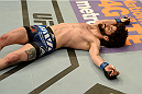 BALTIMORE, MD - APRIL 26:  Charlie Brenneman lays on the canvas after being knocked out by Danny Castillo in their lightweight bout during the UFC 172 event at the Baltimore Arena on April 26, 2014 in Baltimore, Maryland. (Photo by Patrick Smith/Zuffa LLC/Zuffa LLC via Getty Images)