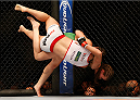 BALTIMORE, MD - APRIL 26:  (R-L) Jessamyn Duke attempts to throw Bethe Correia with a judo toss in their women's bantamweight bout during the UFC 172 event at the Baltimore Arena on April 26, 2014 in Baltimore, Maryland. (Photo by Josh Hedges/Zuffa LLC/Zuffa LLC via Getty Images)