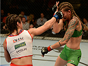 BALTIMORE, MD - APRIL 26:  (L-R) Bethe Correia punches Jessamyn Duke in their women's bantamweight bout during the UFC 172 event at the Baltimore Arena on April 26, 2014 in Baltimore, Maryland. (Photo by Patrick Smith/Zuffa LLC/Zuffa LLC via Getty Images)