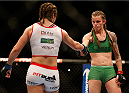 BALTIMORE, MD - APRIL 26:  (R-L) Opponents Jessamyn Duke and Bethe Correia shake hands after the conclusion of their women's bantamweight bout during the UFC 172 event at the Baltimore Arena on April 26, 2014 in Baltimore, Maryland. (Photo by Josh Hedges/Zuffa LLC/Zuffa LLC via Getty Images)