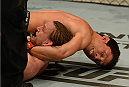 BALTIMORE, MD - APRIL 26:  (R-L) Joseph Benavidez secures a guillotine choke submission against Timothy Elliott in their bantamweight bout during the UFC 172 event at the Baltimore Arena on April 26, 2014 in Baltimore, Maryland. (Photo by Patrick Smith/Zuffa LLC/Zuffa LLC via Getty Images)