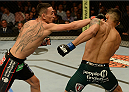 BALTIMORE, MD - APRIL 26:  (L-R) Max Holloway punches Andre Fili in their featherweight bout during the UFC 172 event at the Baltimore Arena on April 26, 2014 in Baltimore, Maryland. (Photo by Patrick Smith/Zuffa LLC/Zuffa LLC via Getty Images)