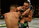 BALTIMORE, MD - APRIL 26:  (R-L) Max Holloway punches Andre Fili in their featherweight bout during the UFC 172 event at the Baltimore Arena on April 26, 2014 in Baltimore, Maryland. (Photo by Patrick Smith/Zuffa LLC/Zuffa LLC via Getty Images)