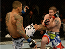 BALTIMORE, MD - APRIL 26:  (L-R) Yancy Medeiros kicks Jim Miller in their lightweight bout during the UFC 172 event at the Baltimore Arena on April 26, 2014 in Baltimore, Maryland. (Photo by Patrick Smith/Zuffa LLC/Zuffa LLC via Getty Images)