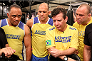 SAO PAULO, BRAZIL - FEBRUARY 6:  (L-R) Team Wanderlei boxing coach Luiz Dorea, jiu jitsu coach Fabio Gurgel, Andre Pederneiras and coach Wanderlei Silva watch the film after team Wanderlei fighter Ismael De Jesus was defeated by Team Sonnen fighter Warlley Alves in their middleweight fight during season three of The Ultimate Fighter Brazil on February 6, 2014 in Sao Paulo, Brazil. (Photo by Luiz Pires Dias/Zuffa LLC/Zuffa LLC via Getty Images) *** Local Caption *** Luiz Dorea; Fabio Gurgel; Andre Pederneiras; Wanderlei Silva