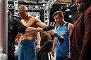 LAS VEGAS, NV - NOVEMBER 1:  (L-R) Team Penn fighter Tim Williams prepares to enter the Octagon as jiu jitsu coach Andre Pederneiras watches before facing team Edgar fighter Dhiego Williams in their preliminary fight during filming of season nineteen of The Ultimate Fighter on November 1, 2013 in Las Vegas, Nevada. (Photo by Jeff Bottari/Zuffa LLC/Zuffa LLC via Getty Images) *** Local Caption *** Tim Williams; Andre Pederneiras
