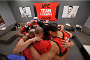 LAS VEGAS, NV - NOVEMBER 1:  Team Edgar huddles up for a prayer before team Edgar fighter Dhiego Lima faces team Penn fighter Tim Williams in their preliminary fight during filming of season nineteen of The Ultimate Fighter on November 1, 2013 in Las Vegas, Nevada. (Photo by Jeff Bottari/Zuffa LLC/Zuffa LLC via Getty Images) *** Local Caption ***