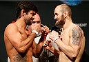 CINCINNATI, OH - MAY 09:  (L-R) Opponents Yan Cabral and Zak Cummings face off during the UFC weigh-in at the U.S. Bank Arena on May 9, 2014 in Cincinnati, Ohio. (Photo by Josh Hedges/Zuffa LLC/Zuffa LLC via Getty Images)
