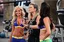 SAO PAULO, BRAZIL - FEBRUARY 8:  (L-R) UFC Octagon Girl Jhenny Andrade talks with UFC Host Paula Sack after Team Wanderlei fighter Jollyson Francino faced Team Sonnen fighter Marcos Rogerio in their heavyweight fight during season three of The Ultimate Fighter Brazil on February 8, 2014 in Sao Paulo, Brazil. (Photo by Luiz Pires Dias/Zuffa LLC/Zuffa LLC via Getty Images) *** Local Caption ***Jhenny Andrade; Paula Sack