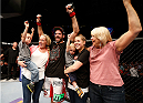 CINCINNATI, OH - MAY 10:  Matt Brown celebrates with his family after his TKO victory over Erick Silva in their welterweight fight during the UFC Fight Night event at the U.S. Bank Arena on May 10, 2014 in Cincinnati, Ohio. (Photo by Josh Hedges/Zuffa LLC/Zuffa LLC via Getty Images)