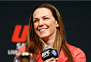 LAS VEGAS, NV - MAY 23:  UFC women's bantamweight title challenger Alexis Davis interacts with fans and media during the UFC press conference at the MGM Grand Garden Arena on May 23, 2014 in Las Vegas, Nevada.  (Photo by Josh Hedges/Zuffa LLC/Zuffa LLC via Getty Images)