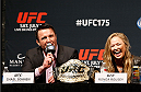 LAS VEGAS, NV - MAY 23:  (L-R) Chael Sonnen and Ronda Rousey interact with fans and media during the UFC press conference at the MGM Grand Garden Arena on May 23, 2014 in Las Vegas, Nevada.  (Photo by Josh Hedges/Zuffa LLC/Zuffa LLC via Getty Images)