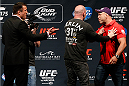 LAS VEGAS, NV - MAY 23:  UFC President Dana White steps between opponents Chael Sonnen (L) and Wanderlei Silva (R) after a heated face off during the UFC press conference at the MGM Grand Garden Arena on May 23, 2014 in Las Vegas, Nevada.  (Photo by Josh Hedges/Zuffa LLC/Zuffa LLC via Getty Images)