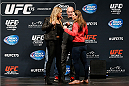 LAS VEGAS, NV - MAY 23:  (L-R) Opponents Ronda Rousey and Alexis Davis face off during the UFC press conference at the MGM Grand Garden Arena on May 23, 2014 in Las Vegas, Nevada.  (Photo by Josh Hedges/Zuffa LLC/Zuffa LLC via Getty Images)