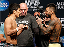 LAS VEGAS, NV - MAY 23:  (L-R) Opponents Takeya Mizugaki and Francisco Rivera face off during the UFC 173 weigh-in at the MGM Grand Garden Arenaon May 23, 2014 in Las Vegas, Nevada.  (Photo by Josh Hedges/Zuffa LLC/Zuffa LLC via Getty Images)