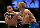 LAS VEGAS, NV - MAY 24:  (R-L) T.J. Dillashaw kicks Renan Barao in their bantamweight championship bout during the UFC 173 event at the MGM Grand Garden Arena on May 24, 2014 in Las Vegas, Nevada. (Photo by Jeff Bottari/Zuffa LLC/Zuffa LLC via Getty Images)