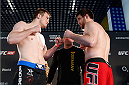 BERLIN, GERMANY - MAY 30:  Opponents Viktor Pesta (L) and Ruslan Magomedov (R) face off during the UFC weigh-in at O2 World on May 30, 2014 in Berlin, Germany.  (Photo by Boris Streubel/Zuffa LLC/Zuffa LLC via Getty Images)