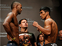 SAO PAULO, BRAZIL - MAY 30:  (L-R) Opponents Kevin Souza and Mark Eddiva of the Philippines face off during the UFC Fight Night weigh-in at the Ginasio do Ibirapuera on May 30, 2014 in Sao Paulo, Brazil.  (Photo by Josh Hedges/Zuffa LLC/Zuffa LLC via Getty Images)