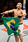 SAO PAULO, BRAZIL - MAY 31: Pedro Munhoz reacts after his TKO victory over Matt Hobar in their bantamweight fight during the UFC Fight Night event at the Ginasio do Ibirapuera on May 31, 2014 in Sao Paulo, Brazil. (Photo by Josh Hedges/Zuffa LLC/Zuffa LLC via Getty Images)