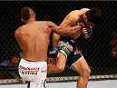 SAO PAULO, BRAZIL - MAY 31: (L-R) Kevin Souza counters a Mark Eddiva kick with a punch in their featherweight fight during the UFC Fight Night event at the Ginasio do Ibirapuera on May 31, 2014 in Sao Paulo, Brazil. (Photo by Josh Hedges/Zuffa LLC/Zuffa LLC via Getty Images)