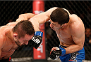 SAO PAULO, BRAZIL - MAY 31: (R-L) Rashid Magomedov punches Rodrigo Damm in their lightweight fight during the UFC Fight Night event at the Ginasio do Ibirapuera on May 31, 2014 in Sao Paulo, Brazil. (Photo by Josh Hedges/Zuffa LLC/Zuffa LLC via Getty Images)