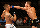 ALBUQUERQUE, NM - JUNE 07:  (R-L) Sergio Pettis punches Yaotzin Meza in their bantamweight fight during the UFC Fight Night event at Tingley Coliseum on June 7, 2014 in Albuquerque, New Mexico.  (Photo by Josh Hedges/Zuffa LLC/Zuffa LLC via Getty Images)
