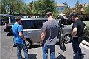 Ultimate Fighter 1 winner Forrest Griffin shows off the Scion to some UFC employees.