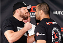 "VANCOUVER, CANADA - JUNE 12:  (L-R) Opponents Ryan Bader and Rafael ""Feijao"" Cavalcante face off at the EA Sports Capture Lab on June 12, 2014 in Vancouver, British Columbia, Canada. (Photo by Josh Hedges/Zuffa LLC/Zuffa LLC via Getty Images)"