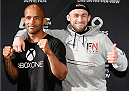 VANCOUVER, CANADA - JUNE 12:  (L-R) Opponents Demetrious Johnson and Ali Bagautinov pose for photos at the EA Sports Capture Lab on June 12, 2014 in Vancouver, British Columbia, Canada. (Photo by Josh Hedges/Zuffa LLC/Zuffa LLC via Getty Images)