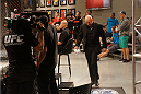 UFC president Dana White makes his way into the Octagon to announce which light heavyweight is moving on the to the finale.