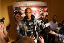 SAN ANTONIO, TX - JUNE 26:  Nico Musoke speaks to the media after his open training session at the Grand Hyatt San Antonio on June 26, 2014 in San Antonio, Texas. (Photo by Ed Mulholland/Zuffa LLC/Zuffa LLC via Getty Images)