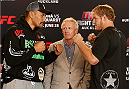 AUCKLAND, NEW ZEALAND - JUNE 26:  (L-R) Opponents Soa Palelei and Jared Rosholt face off during the UFC Ultimate Media Day at The Cloud at Queen's Wharf on June 26, 2014 in Auckland, New Zealand.  (Photo by Josh Hedges/Zuffa LLC/Zuffa LLC via Getty Images)