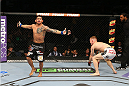 SAN ANTONIO, TX - JUNE 28:  Carlos Diego Ferreira (left) reacts to his submission victory over Colton Smith (white shorts) in their lightweight bout at the AT&T Center on June 28, 2014 in San Antonio, Texas. (Photo by Ed Mulholland/Zuffa LLC/Zuffa LLC via Getty Images)