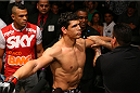 SAN ANTONIO, TX - JUNE 28:  Cezar Ferreira (center) prepares to enter the Octagon as training partner Vitor Belfort looks on at the AT&T Center on June 28, 2014 in San Antonio, Texas. (Photo by Ed Mulholland/Zuffa LLC/Zuffa LLC via Getty Images)
