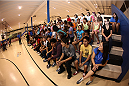 LAS VEGAS, NV - JULY 1:  Children from the Boys & Girls Club of Las Vegas interact with UFC fighters Daniel Cormier and Matt Hughes as the UFC, Ultimate Alliance and Boys & Girls Club of Las Vegas announce a partnership to host after school wrestling programs to kick off the UFC International Fight Week at the Boys & Girls Club of Southern Nevada on July 1, 2014 in Las Vegas, Nevada. (Photo by Brandon Magnus/Zuffa LLC/Zuffa LLC via Getty Images)