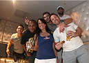 LAS VEGAS, NV - JULY 1:  (L-R) Joseph Benavidez, Daniel Cormier, Luke Rockhold, and UFC Welterweight Champ Johnny Hendricks pose with fans as they watch the 2014 FIFA World Cup Brazil Round of 16 match between USA and Belgium with fans to kick off the UFC International Fight Week at Legasse's Stadium at The Palazzo Las Vegas on July 1, 2014 in Las Vegas, Nevada. (Photo by Brandon Magnus/Zuffa LLC/Zuffa LLC via Getty Images)