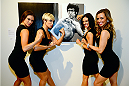 LAS VEGAS, NV - JULY 1:  (L-R) Cast members from the production show Fantasy, Danielle, Kristin, Tracey and Mariah pose in front of art work at the Art of Fighting Exhibition to kick off the UFC International Fight Week at The Gallery on 1217 on July 1, 2014 in Las Vegas, Nevada. (Photo by Jeff Bottari/Zuffa LLC/Zuffa LLC via Getty Images)