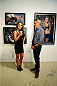 LAS VEGAS, NV - JULY 1:  (R-L) Artist Justin Bua is interviewed by UFC Octagon Girl and exhibition artist Brittney Palmer at the Art of Fighting Exhibition to kick off the UFC International Fight Week at The Gallery on 1217 on July 1, 2014 in Las Vegas, Nevada. (Photo by Jeff Bottari/Zuffa LLC/Zuffa LLC via Getty Images)