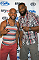 LAS VEGAS, NV - JULY 2:  UFC flyweight champion Demetrious 'Mighty Mouse' Johnson (L) and UFC middleweight fighter Tyron Woodley arrive at the advanced screening of the Twentieth Century Fox film 'Let's Be Cops' during UFC International Fight Week at Brooklyn Bowl Las Vegas at The LINQ on July 2, 2014 in Las Vegas, Nevada. (Photo by Al Powers/Zuffa LLC/Zuffa LLC via Getty Images)