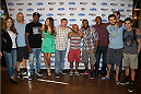 LAS VEGAS, NV - JULY 2:  (L-R) UFC personalities Brittney Palmer, Chuck Liddell, Phil Davis, Vanessa Hanson, Matt Hughes, Demetrious Johnson, Tyron Woodley, Rashad Evans, Carlos Condit and Dominikc Cruz arrive at the advanced screening of the Twentieth Century Fox film 'Let's Be Cops' during UFC International Fight Week at Brooklyn Bowl Las Vegas at The LINQ on July 2, 2014 in Las Vegas, Nevada. (Photo by Al Powers/Zuffa LLC/Zuffa LLC via Getty Images)