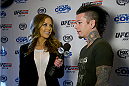 LAS VEGAS, NV - JULY 2:  Guitarist Dj Ashba of Guns N' Roses (R) is interviewed by UFC Octagon Girl Brittney Palmer at the advanced screening of the Twentieth Century Fox film 'Let's Be Cops' during UFC International Fight Week at Brooklyn Bowl Las Vegas at The LINQ on July 2, 2014 in Las Vegas, Nevada. (Photo by Al Powers/Zuffa LLC/Zuffa LLC via Getty Images)