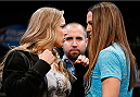 BESTPIX - LAS VEGAS, NV - JULY 03:  (L-R) Opponents Ronda Rousey and Alexis Davis face off during the UFC Ultimate Media Day at the Mandalay Bay Resort and Casino on July 3, 2014 in Las Vegas, Nevada.  (Photo by Josh Hedges/Zuffa LLC/Zuffa LLC via Getty Images)