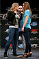 LAS VEGAS, NV - JULY 03:  (L-R) Opponents Ronda Rousey and Alexis Davis face off during the UFC Ultimate Media Day at the Mandalay Bay Resort and Casino on July 3, 2014 in Las Vegas, Nevada.  (Photo by Josh Hedges/Zuffa LLC/Zuffa LLC via Getty Images)