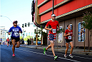 LAS VEGAS, NV - JULY 4:  Participates run in the first annual Ulti-man 5K run during UFC International Fight Week at Hogs and Heifers on July 4, 2014 in Las Vegas, Nevada. Proceeds will help support Three Square Food Bank. (Photo by Brandon Magnus/Zuffa LLC/Zuffa LLC via Getty Images)